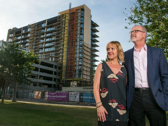 Steve and Victoria Lindley stand outside the construction