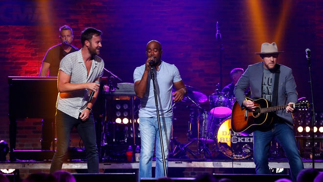 Charles Kelley, left, Darius Rucker and Nathan Chapman perform during a CMA Songwriters Series taping.