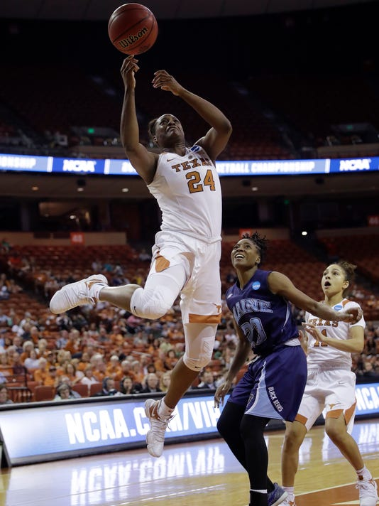 Texas forward Joyner Holmes (24) shoots over Maine guard Tanesha Sutton (23) during a first-round game in the NCAA women's college basketball tournament, Saturday, March 17, 2018, in Austin, Texas. (AP Photo/Eric Gay)