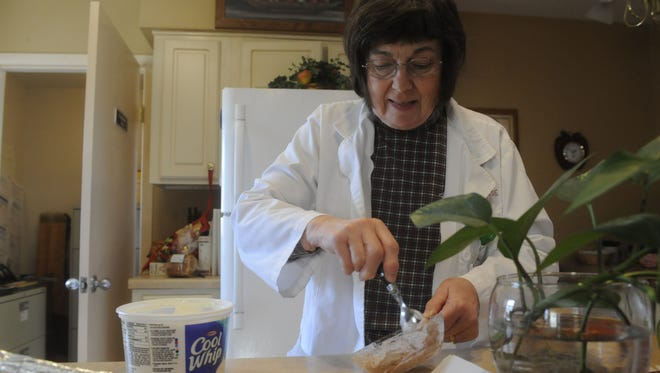 """Jan Halligan whips up something tasty and low-carb for people with diabetes on Monday. Halligan, a registered dietitian with Reppell Diabetes Learning Center, will lead a series of cooking programs in 2015 called """"Taste of Healthy."""""""