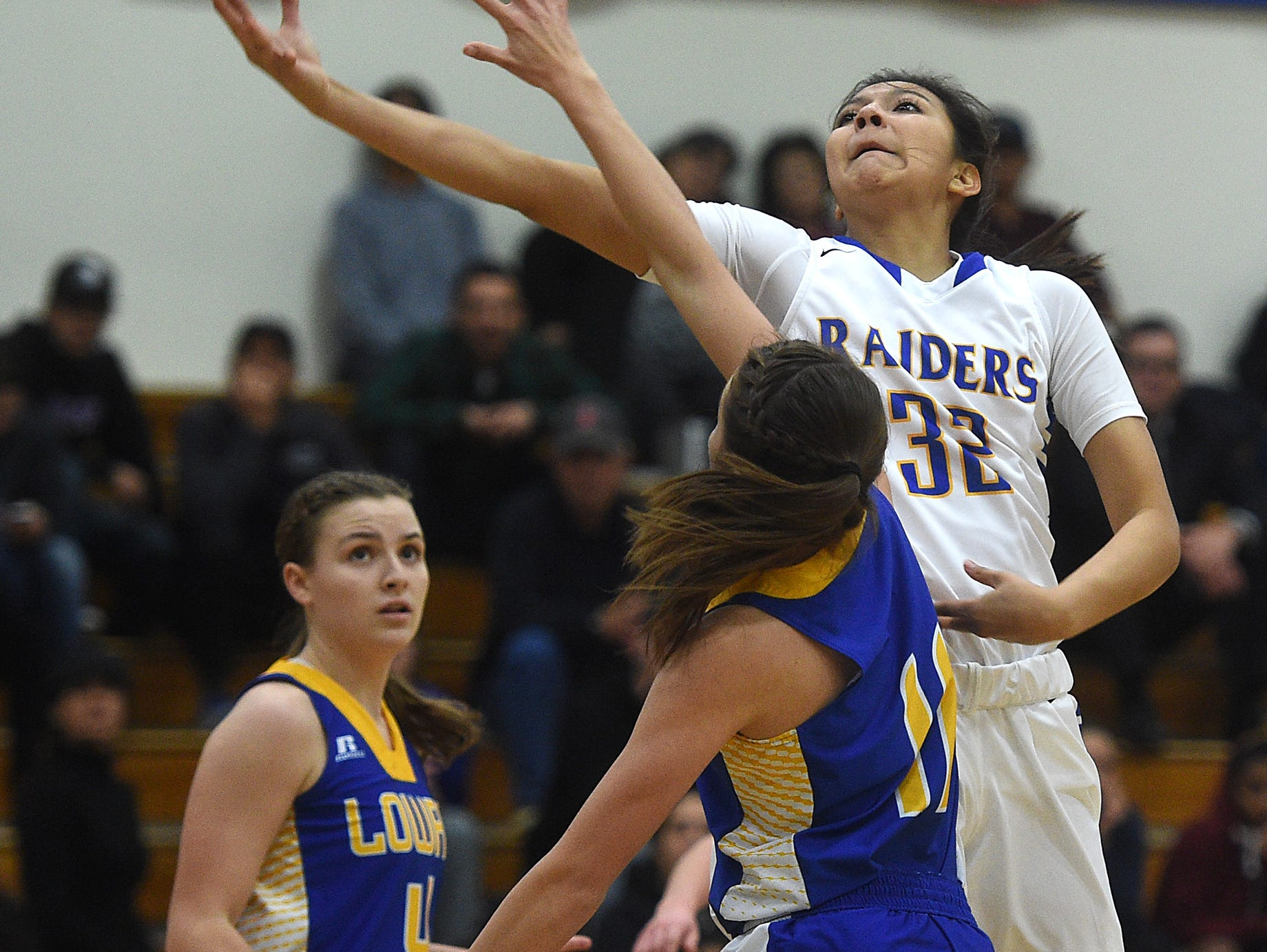Reed's Larsa Guzman (32) drives while taking on Lowry during their basketball game Wednesday at McQueen