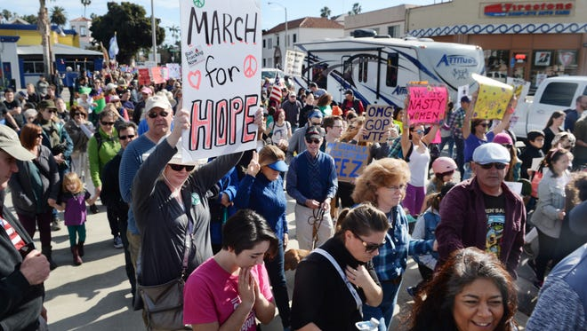 Demonstrators march on Ventura's Thompson Boulevard a year ago the day after President Donald Trump's inauguration. A second-anniversary march will be held Saturday.