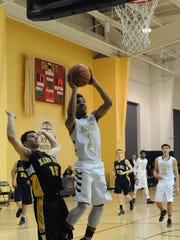 DePaul Cristo Rey senior Zach Jones scores on a layup in a 2016 game.