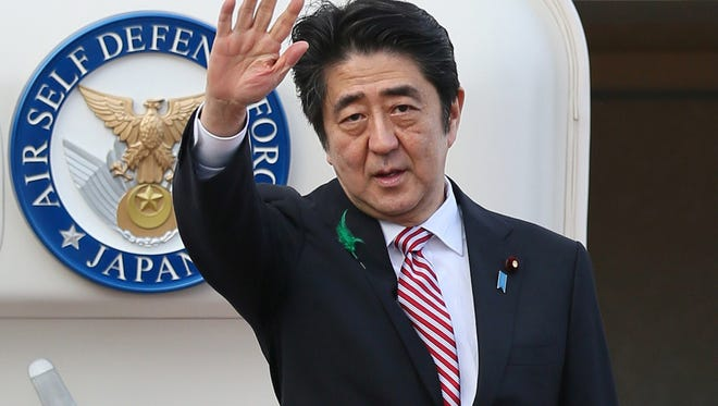 Japanese Prime Minister Shinzo Abe leaves for Indonesia at the Tokyo International Airport on April 21, 2015.