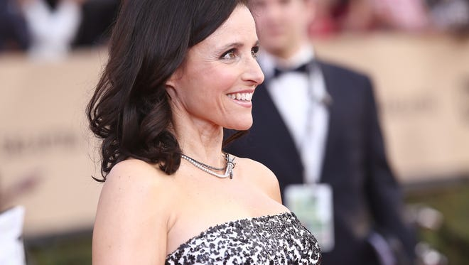 Julia Louis-Dreyfus arrives at the 22nd annual Screen Actors Guild Awards at the Shrine Auditorium & Expo Hall on Saturday, Jan. 30, 2016, in Los Angeles. (Photo by John Salangsang/Invision/AP)