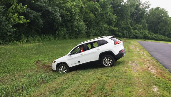 "A Jeep Cherokee winds up in a ditch after hackers working with ""Wired"" magazine successfully take control of the vehicle by hacking in through its connected-car infotainment system."