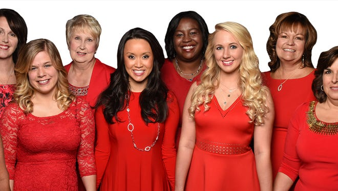 A dozen Cincinnati women flashed their wardrobe red at the 2016 Go Red for Women day.