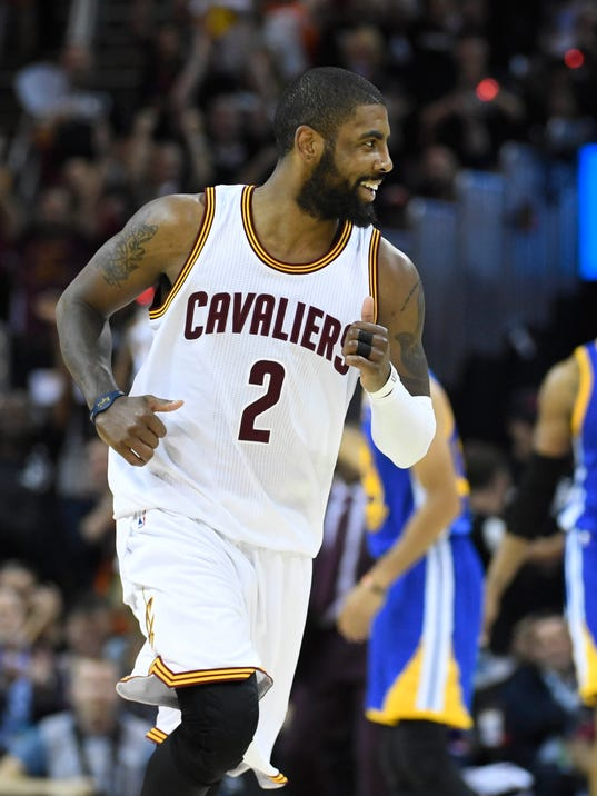 Kyrie Irving, LeBron James combine for 71, Cavaliers down Warriors