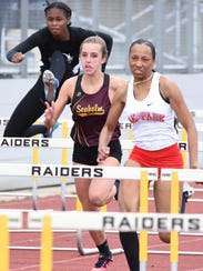 Junior Heather Meadows (center) finished 13th in the