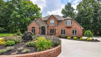 Look inside this $825K home overlooking Wildcat Creek, with a separate building for entertaining.