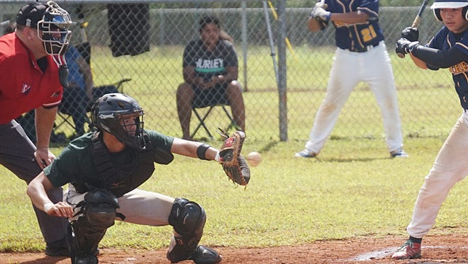 John F. Kennedy Islanders senior A.J. Benavente receives a pitch during the Independent Interscholastic Athletic Association of Guam Baseball League game against the Guam High Panthers at Harmon sports complex on Saturday, Nov. 7. Benavente had three home runs in the win.