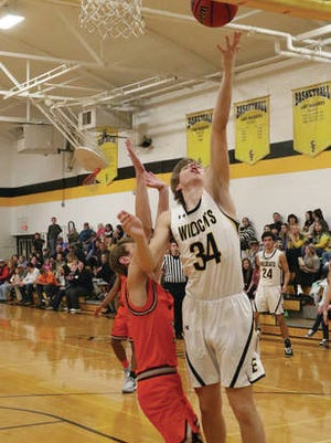 Logan Wilkins (34) finished with 10 points Tuesday night, one of Santa Fe's four doublt-digit scorers in a 69-59 District 10-A win over visiting Richland.