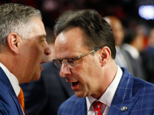 Georgia coach Tom Crean shakes hands with Auburn coach Bruce Pearl before the start a game Wednesday, Feb. 27, 2019, in Athens, Ga.