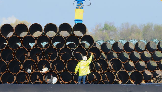 Pipes for the proposed Dakota Access oil pipeline, which would stretch from the Bakken oil fields in North Dakota to Patoka, Ill., are stacked May 9, 2015, at a staging area in Worthing, S.D.