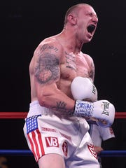 U.S. Army Veteran Blake  McKernan celebrates his TKO