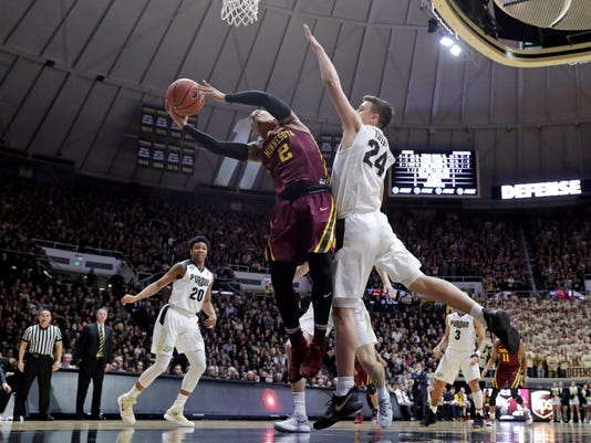Minnesota guard Nate Mason (2) shoots under Purdue forward Grady Eifert (24) in the first half of an NCAA college basketball game in West Lafayette, Ind., Sunday, Feb. 25, 2018. (AP Photo/Michael Conroy)