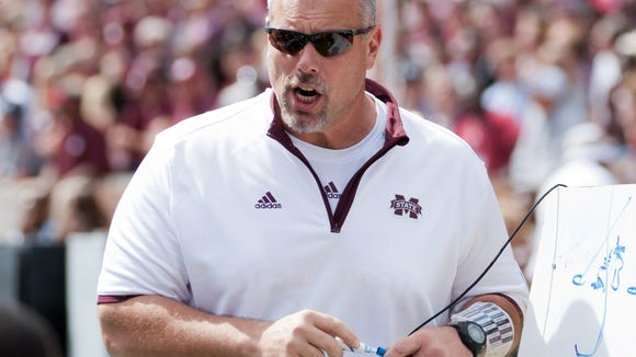 Oct 4, 2014; Starkville, MS, USA; Mississippi State Bulldogs co-offensive coordinator John Hevesy talks to his team during the game against the Texas A&M Aggies at Davis Wade Stadium. Mandatory Credit: Marvin Gentry-USA TODAY Sports