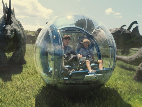 """APNick Robinson, left, as Zach, and Ty Simpkins as Gray, take a ride through """"Jurassic World,"""" the $1 billion latest installment in the """"Jurassic Park"""" series. This photo provided by Universal Pictures shows, Nick Robinson, left, as Zach, and Ty Simpkins as Gray, in a scene from the film, """"Jurassic World,"""" directed by Colin Trevorrow, in the next installment of Steven Spielberg's groundbreaking """"Jurassic Park"""" series. (ILM/Universal Pictures/Amblin Entertainment via AP)"""