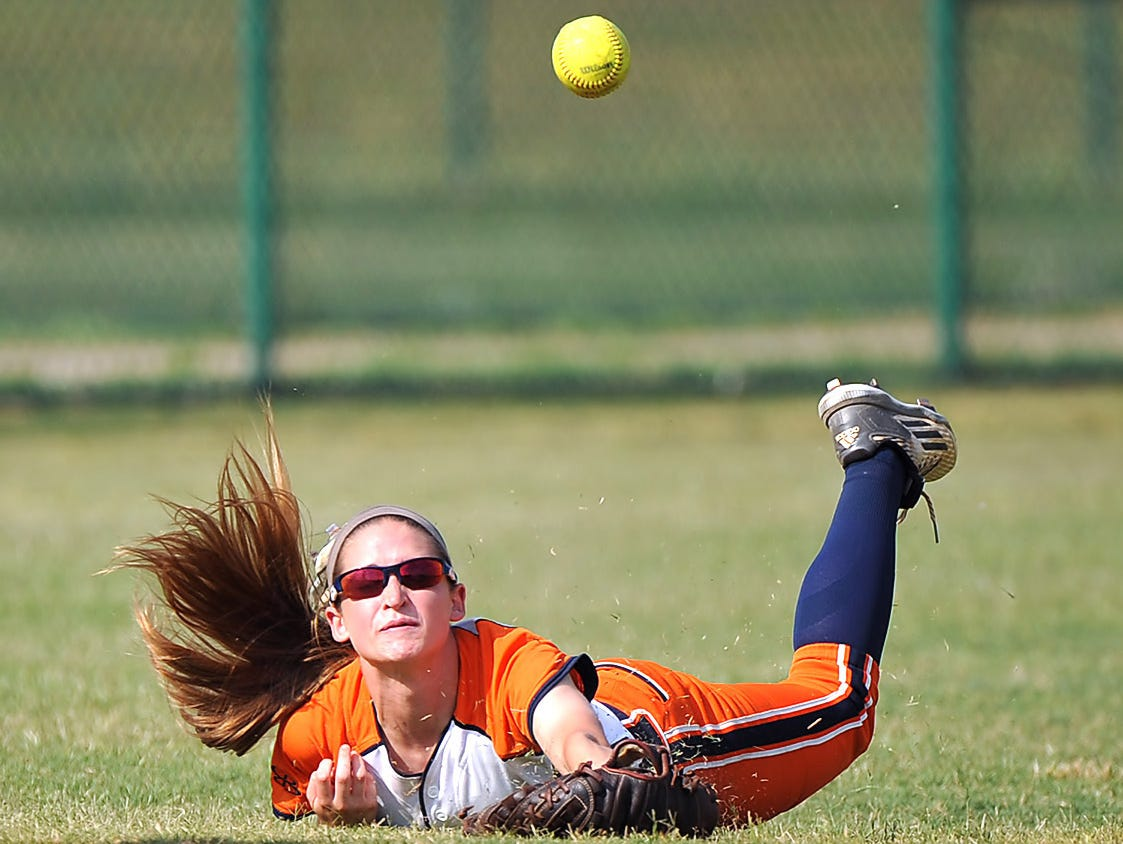 Dickson County's Savannah Mathis goes all out to try and snag a short pop up in left field in the Class AAA softball championship game on May 27, 2016.