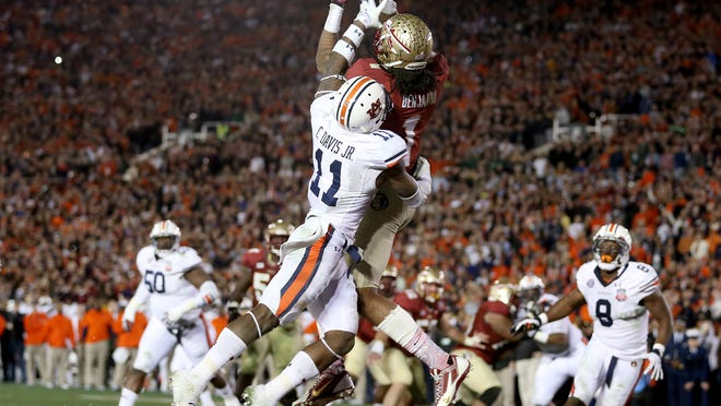 Glenn Beil/Tallahassee Democrat The image of Kelvin Benjamin catching the game-winning touchdown pass has become an iconic symbol of FSU's third national title. It capped off a last-minute drive engineered by FSU head coach Jimbo Fisher. Glenn Beil/Democrat Florida State receiver Kelvin Benjamin leaps and makes the game-winning catch against Auburn in last Januaryâ??s BCS title game at Rose Bowl Stadium in Pasadena, California. The image of Kelvin Benjamin catching the game-winning touchdown pass has become an iconic symbol of FSUâÂ?Â?s third national title. Glenn Beil/ Democrat as Florida State defeats Auburn 34-31 to take the BCS National Championship game on Monday Jan., 6, 2014. The Florida State Seminoles used late game heroics to take down the Auburn Tigers at the Rose Bowl in Pasadena, CA.