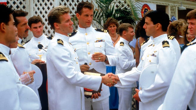Val Kilmer, left, shakes hands with Tom Cruise in 'Top Gun.'