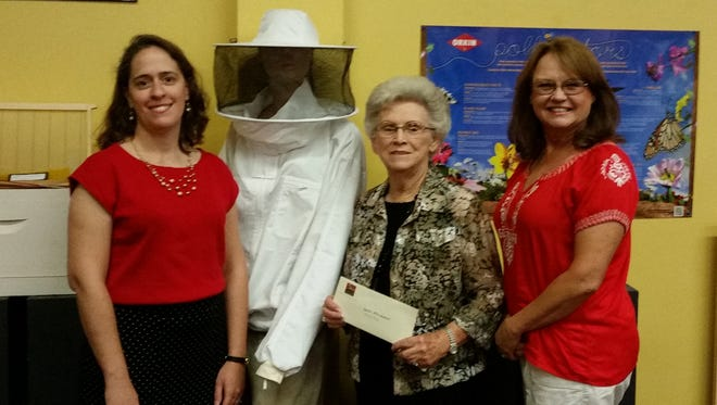 rs. Faye Staton of  the WebbCraft Family Foundation presents a check to BAMA executive director Abigail Burden and organizer Alison Darby.