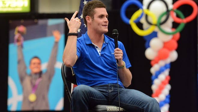 Welcome home for Olympic gold medalist diver David Boudia. Boudia is expected to address the crowd and will receive a proclamation from Mayor John Ditslear.