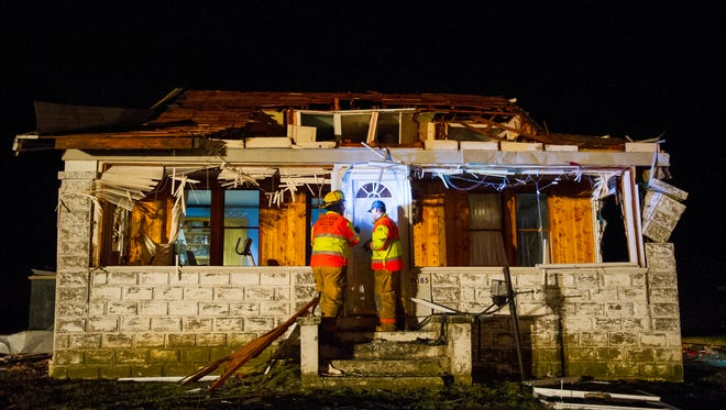 Members of the White River - Hazleton Volunteer Fire Department, Jeff Splittorff, left, and Jake Blanton, begin to search a damaged home along County Road 1000 S in Poseyville, Wednesday, March 1, 2017., Wednesday, March 1, 2017.