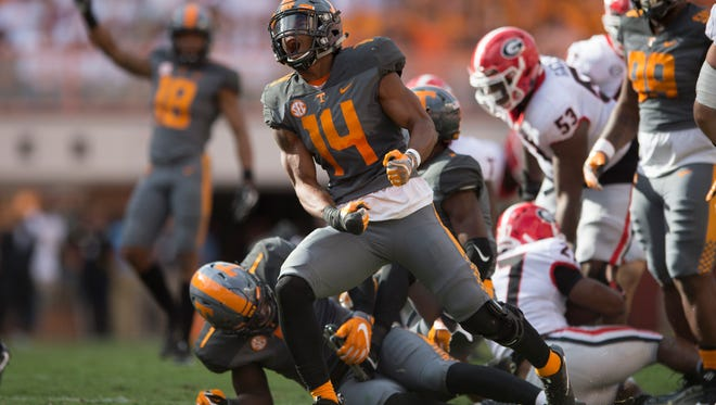 Tennessee Vols linebacker Quart'e Sapp (14) celebrates after making a play against Georgia on Sept. 30, 2017. Sapp has led the team in tackles in each of his two starts.