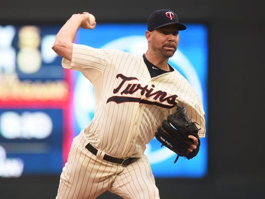 FILE - In this Saturday Sept. 19, 2015 file photo, Minnesota Twins pitcher Mike Pelfrey throws against the Los Angeles Angels in the first inning in Game 2 of a split double header baseball game in Minneapolis. A person with knowledge of the deal says the Detroit Tigers have reached a $16 million, two-year agreement with free-agent right-hander Mike Pelfrey, Friday, Dec. 4, 2015. (AP Photo/Richard Marshall, File)