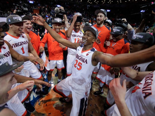 Virginia players celebrate after defeating North Carolina in the championship game of the NCAA Atlantic Coast Conference men's college basketball tournament, Saturday, March 10, 2018, in New York. (AP Photo/Julie Jacobson)
