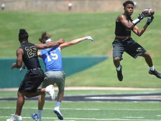 Abilene High defender Jordan Booker, right, picks off