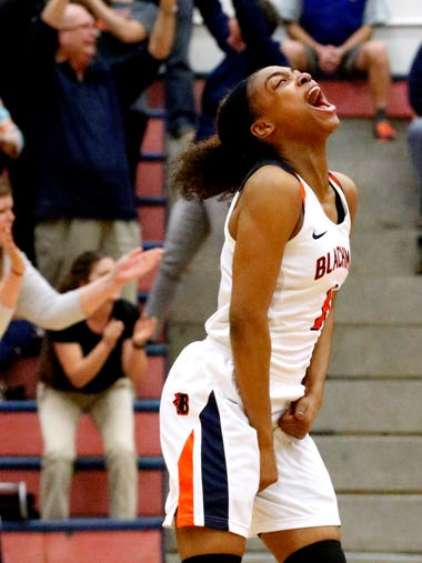 Blackman's Ja'Leah Goff (1) reacts after beating Stewarts