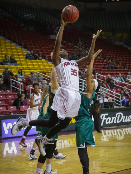 NMSU BASKETBALL: Mack's Career Night Lifts Aggies Past UVU