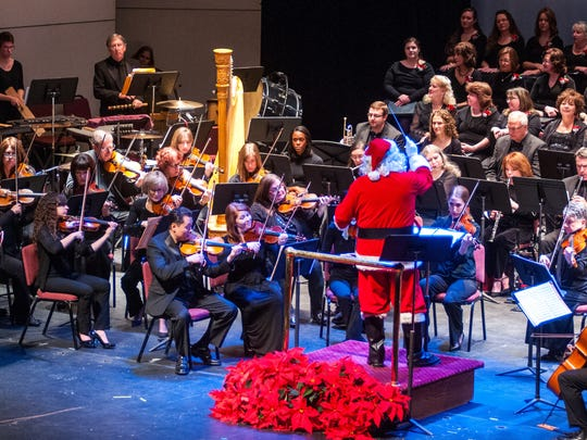 Santa directs the Mansfield Symphony Orchestra and Chorus during the annual pops concert.