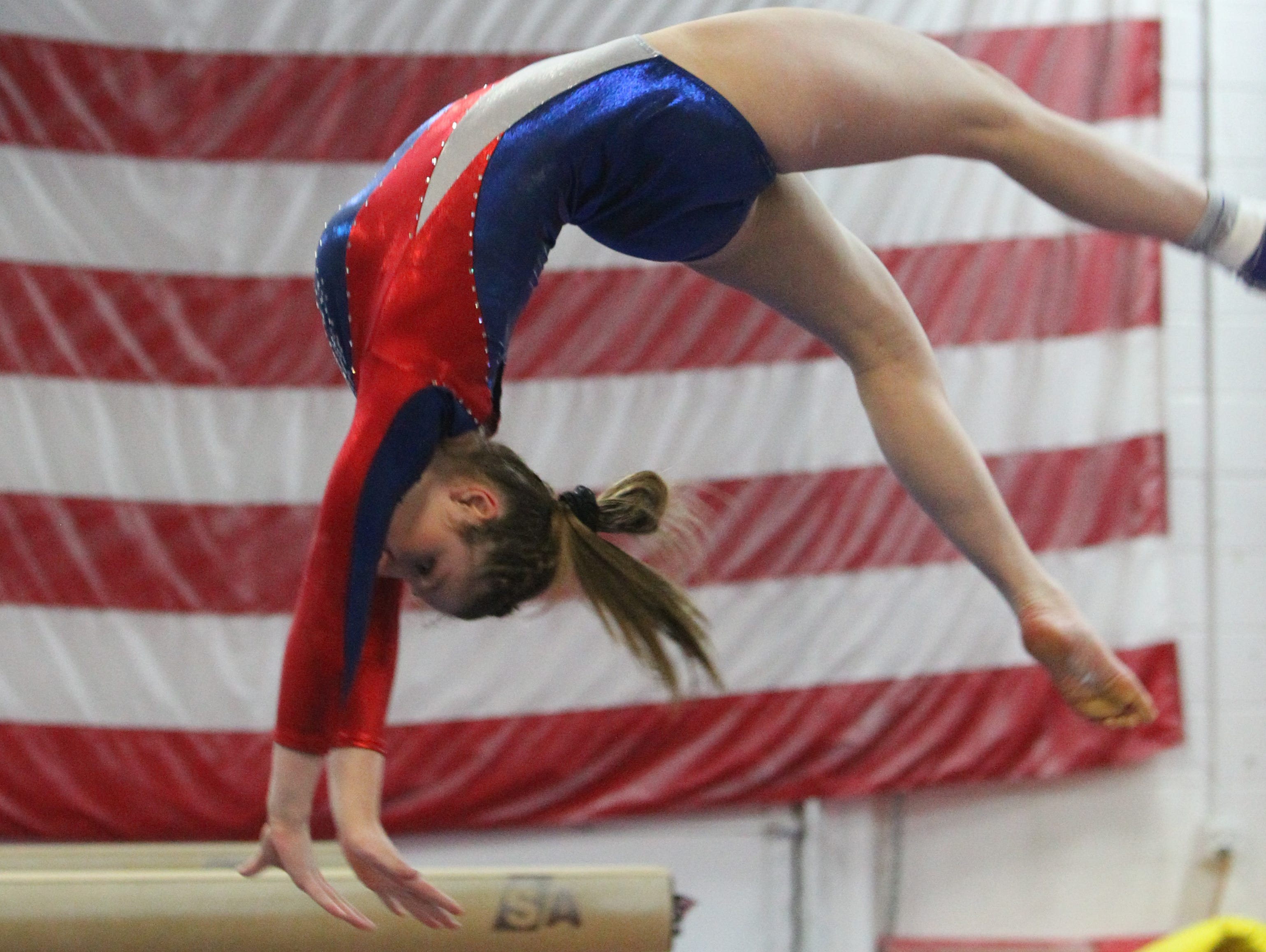 Wappingers' Olivia Frederick performs on the balance beam at the Section 1 Division I and II gymnastics championships at Odyssey Gymnastics Center in Mahopac on Feb. 6.
