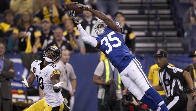 Indianapolis Colts cornerback Pierre Desir (35) intercepts the ball as Pittsburgh Steelers wide receiver Martavis Bryant (10) looks on in the first half of their game at Lucas Oil Stadium Sunday, Nov 12, 2017.