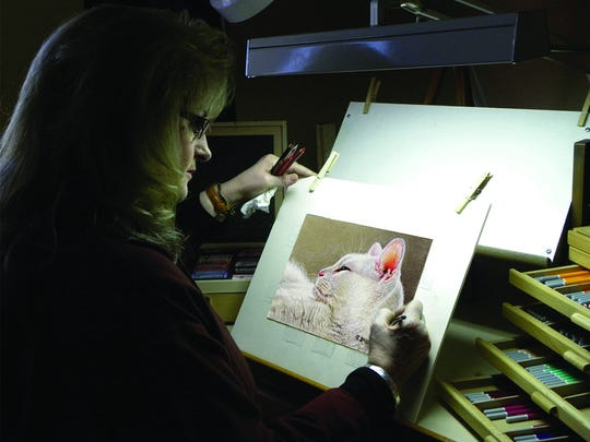 Artist Roby Baer paints wildlife and companion animals.