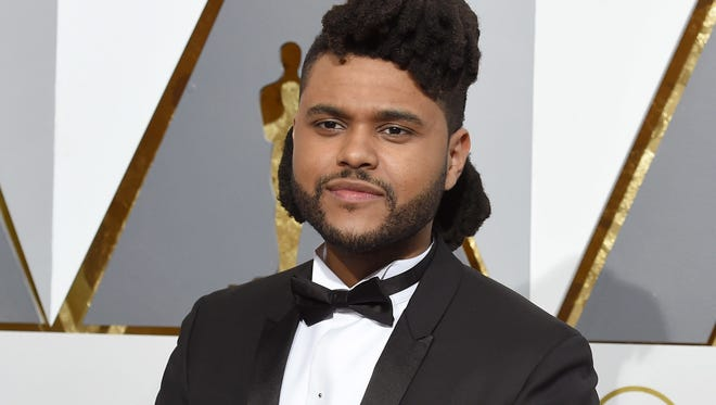 The Weeknd arrives at the Oscars  in Los Angeles.