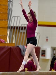 Roosevelt's Sydney Cork competes on the beam during