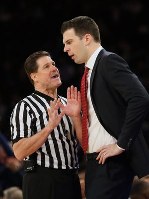 Louisville Cardinals interim head coach David Padgett reacts with an official in the second half against the Memphis Tigers at Madison Square Garden in New York on Saturday, Dec. 16, 2017.