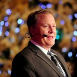 ESPN baseball analyst Curt Schilling talks during the MLB Winter Meetings at the Walt Disney World Swan and Dolphin Resort.  Schilling is joining ESPN's Sunday Night Baseball broadcast as a color commentator.