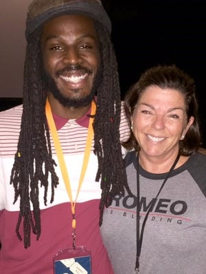 """Spoken-word artist Donte Clark (pictured here with Peggy Meyer), will be in Indianapolis for the screening of """"Romeo is Bleeding"""" on Feb. 16."""