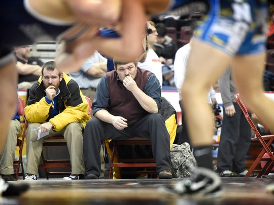 Northern Lebanon wrestling coach Rusty Wallace, center, watches the Vikings' Luis Negerios battle Tyler Park of Brookville during the PIAA wrestling tournament at the Giant Center in Hershey Thursday, Feb. 9. NL earned a 29-27 victory.