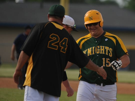 Northeastern assistant coach Brad Fisher congratulates Garrett Dill after his single against Centerville during the IHSAA Class 2A Sectional 41 semifinal Thursday, May 26, 2016.