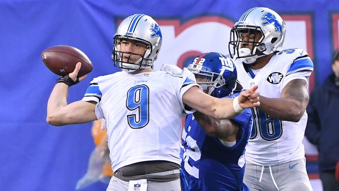 Lions' Matthew Stafford has to throw the ball away in the fourth quarter Sunday.
