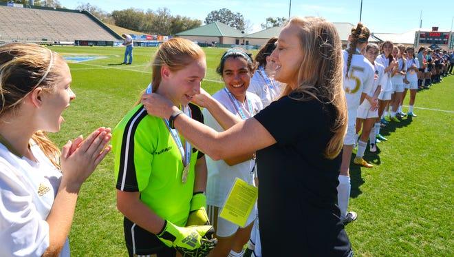Jordan Tomberlin gets her medal. Merritt Island won the girls 3A soccer championship over Stanton on Friday.