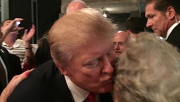 Beada Corum embraces with GOP nominee Donald Trump