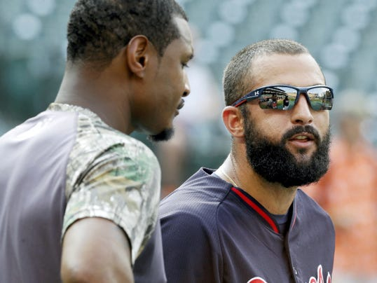 Atlanta Braves right fielder Nick Markakis, right, chats with Baltimore Orioles center fielder Adam Jones before Monday's game in Baltimore. They were longtime teammates in Baltimore.