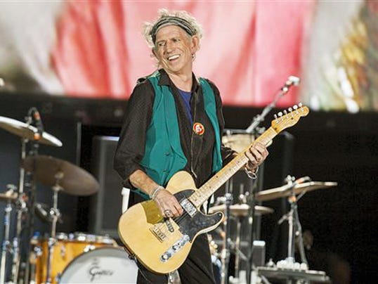 "Keith Richards plays with the Rolling Stones in July at the Le Festival d'ete de Quebec in Quebec City, Canada. Richards released a solo album, ""Crosseyed Heart,"" last week."